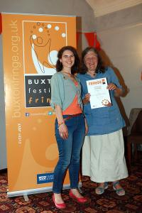 Barbara Wilson (right) collects the Film award on behalf of Buxton Film from Maria Carnegie