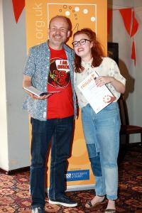 Robbie Carnegie presents the Youth Actor award to Eleanor Hibbert