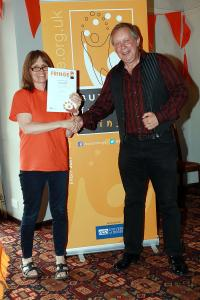 Sam Slide collects his award for 'Spirit of the Fringe' from Marketing Officer Stephanie Billen