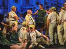 Soldiers and cigarette girls from the recent production of Carmen