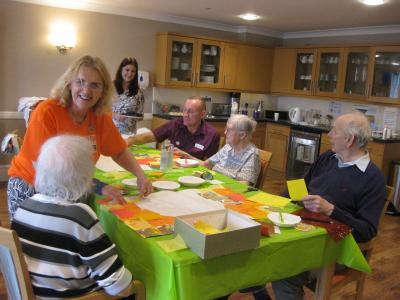 The Fringe's Linda Rolland helps residents at Haddon Hall Care Home make Fringe40 banners as part of our Community Links programme 2019